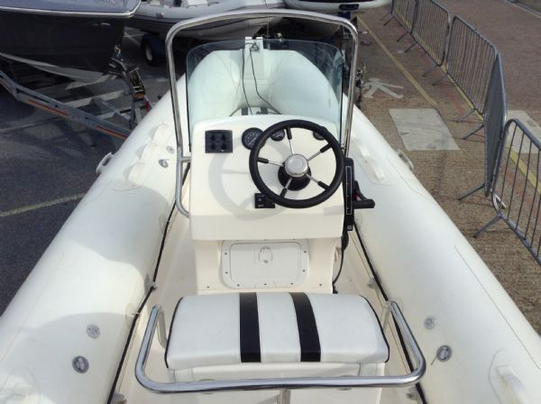 1477 - stock - rapid 520 rib with mercury 60hp engine and trailer - helm_l