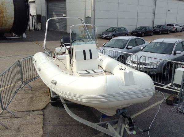 1477 - stock - rapid 520 rib with mercury 60hp engine and trailer - main shot 1_l