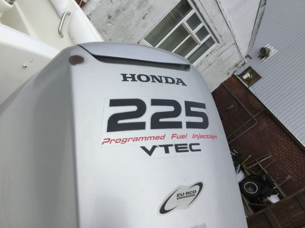 1473 - brokerage - cougar r8 rib with honda bf225 outboard engine - rear of honda cowling_l
