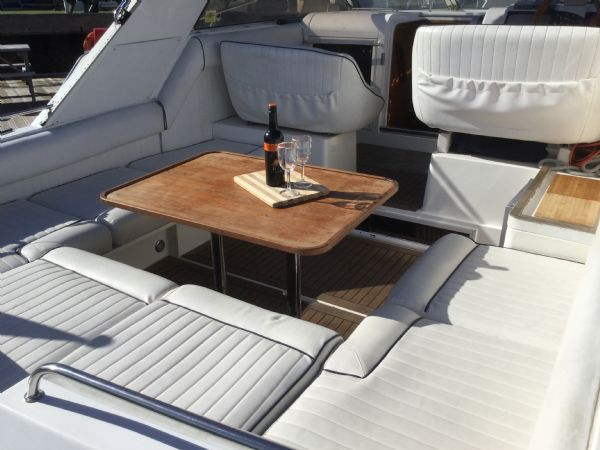 1469 - brokerage -fairline targa 33 with twin volvo kad300 edc engines - cockpit table_l