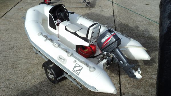 1247 - zodiac 3.4 rib with yamaha 25 two stroke and trailer - from above_l