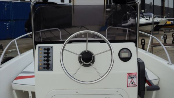 1267 selva 530 hard with evinrude etec 25hp engine and trailer - helm_l (1)