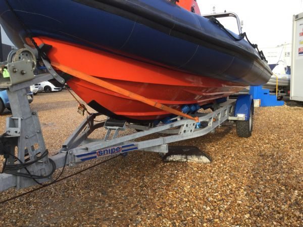1449 - brokerage - xs600 rib with mercury 115 four stroke engine - port side hull and trailer_l