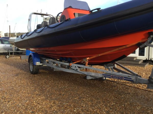1449 - brokerage - xs600 rib with mercury 115 four stroke engine - starboard side hull and trailer_l