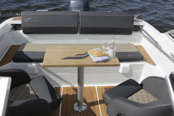 finnmaster 55 bow rider with yamaha engine - rear seating area in cockpit with table_l