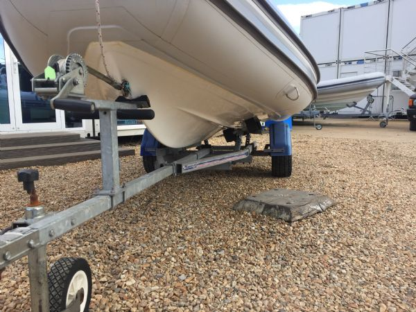 1436 - excel 470 rib with evinrude 60hp outboard engine and trailer - hull and trailer port side_l
