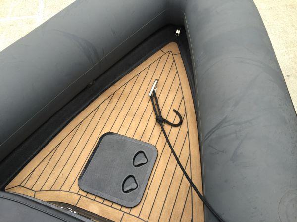 1434 - ribcraft 585 rib with suzuki 140hp outboard engine - anchor locker_l