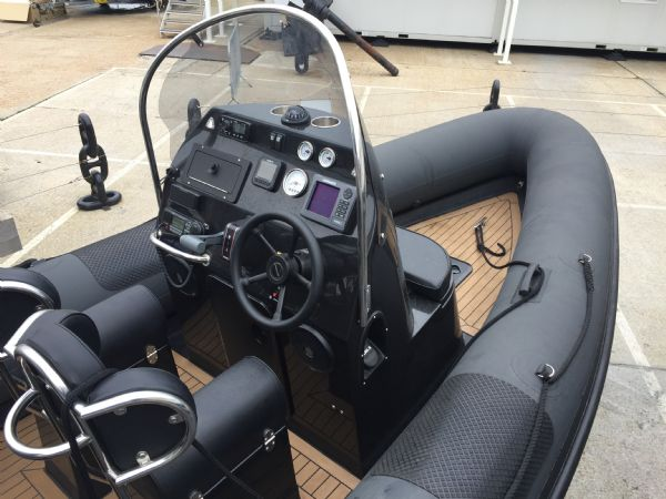 1434 - ribcraft 585 rib with suzuki 140hp outboard engine - bow and console overview_l