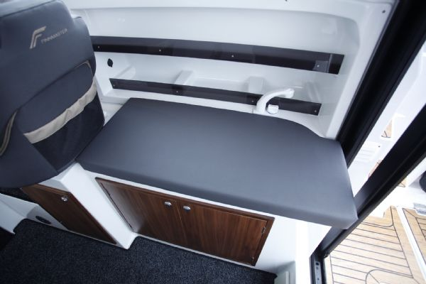 finnmaster pilot 7 weekend with yamaha outboard engine - cushion over sink_l