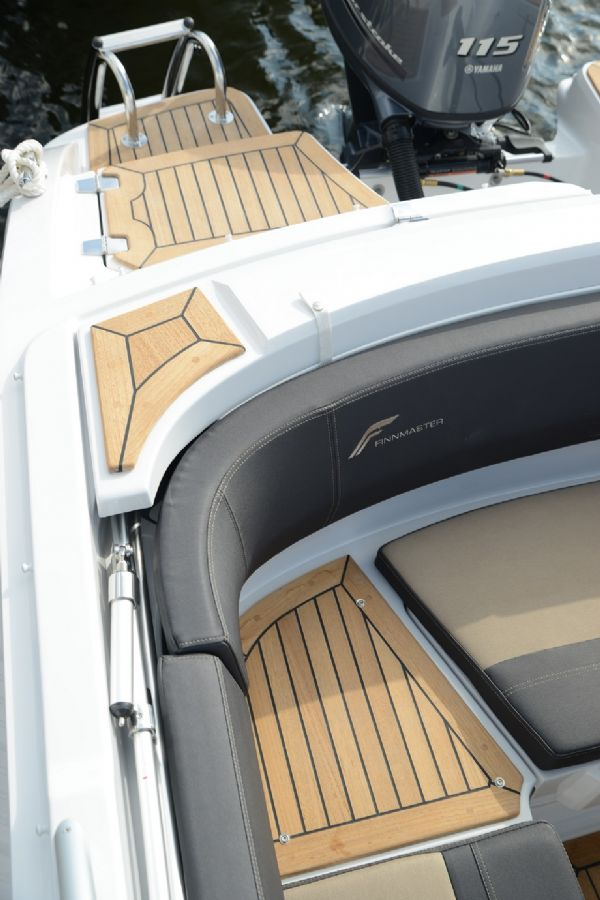 finnmaster 62 day cruiser with yamaha outboard engine - canopy storage and teak decking on bathing platforms_l