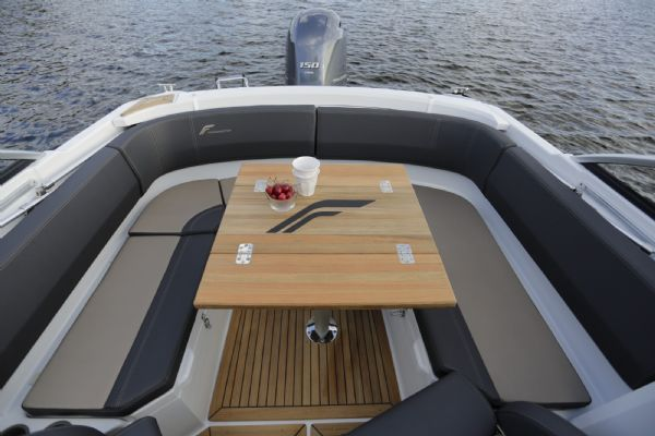 finnmaster 62 day cruiser with yamaha outboard engine - rear bench seating area and cockpit table_l