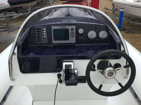 1429 - renegade 720 with mariner 150hp outboard engine and trailer - console_l