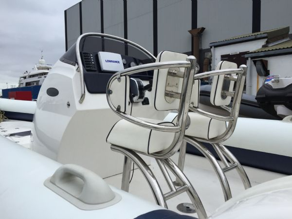 1429 - renegade 720 with mariner 150hp outboard engine and trailer - jockey seats and console_l