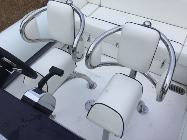 1429 - renegade 720 with mariner 150hp outboard engine and trailer - winged helm seats_l
