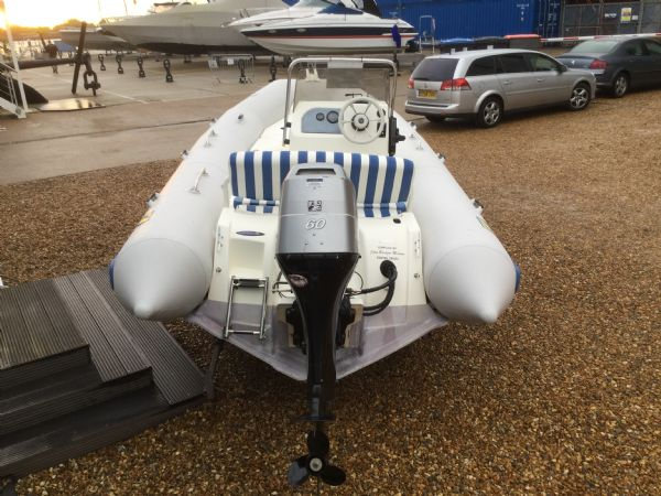 1409 - zodiac medline rib with mariner 60hp outboard engine and trailer - aft_l