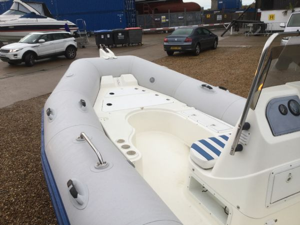 1409 - zodiac medline rib with mariner 60hp outboard engine and trailer - bow area_l