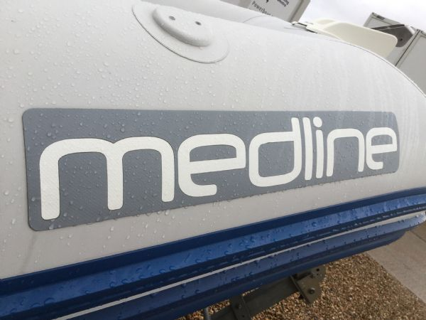 1409 - zodiac medline rib with mariner 60hp outboard engine and trailer - medline logo (2)_l