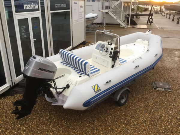 1409 - zodiac medline rib with mariner 60hp outboard engine and trailer - rear starboard quarter_l