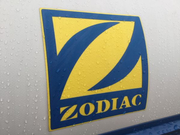 1409 - zodiac medline rib with mariner 60hp outboard engine and trailer - zodiac logo_l