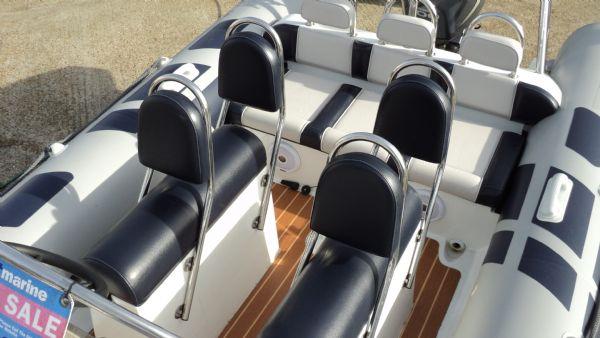 stock - 1355 - ribeye 600 rib with yamaha f100det engine -rear seating_l
