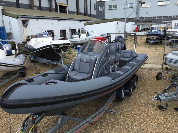 ribquest 7.3 rib with suzuki df250 and trailer - above front_l