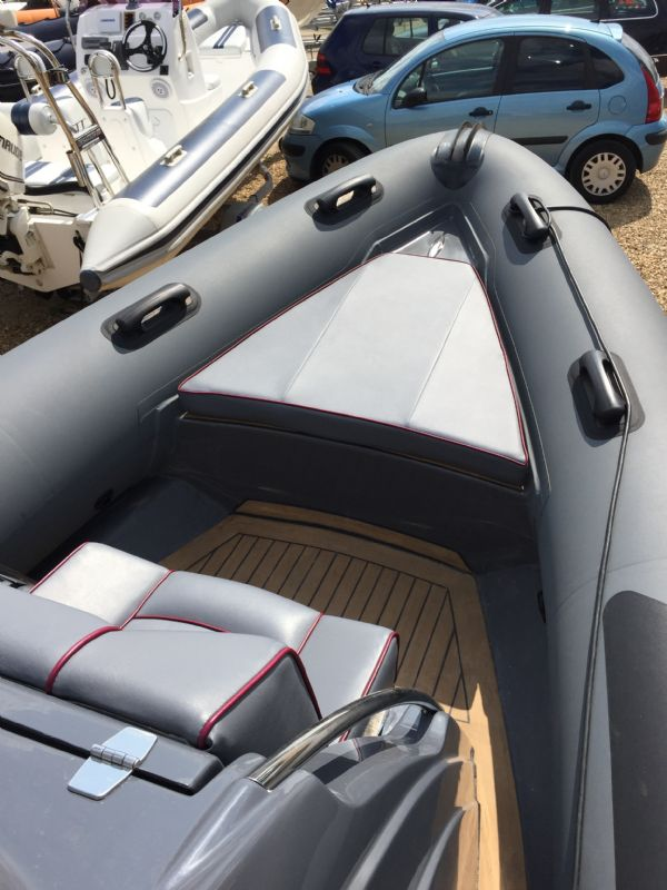 ribquest 7.3 rib with suzuki df250 and trailer - anchor locker seat_l