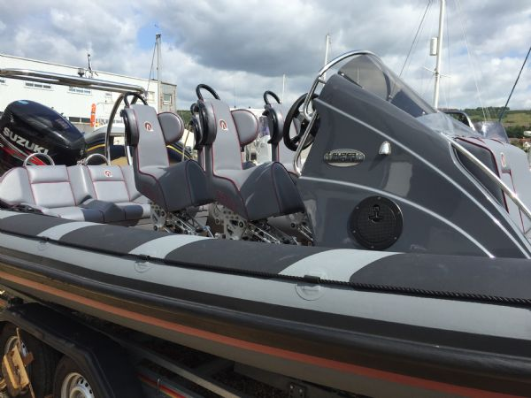 ribquest 7.3 rib with suzuki df250 and trailer - side_l