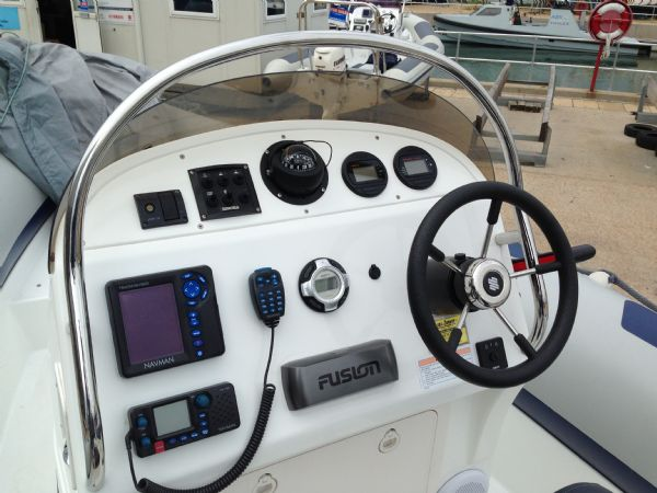 ribeye 650 rib with yamaha f150 and roller trailer - console_l