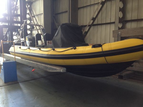 xs ribs 600 rib with mercury 150 optimax and trailer - front_l