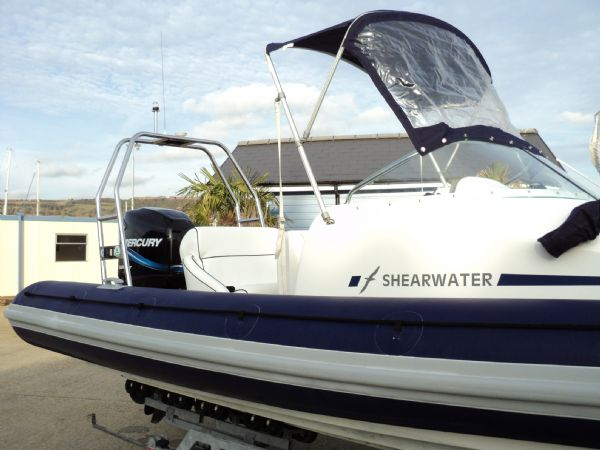 shearwater 7.5 with mercury 200hp outboard engine - stern with bimini 9_l