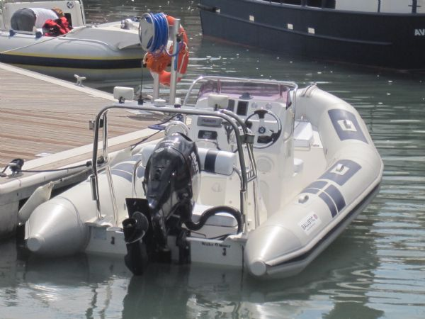 ballistic 5.5m rib with evinrude e-tec 90hp outboard engine on drystack pontoon_l