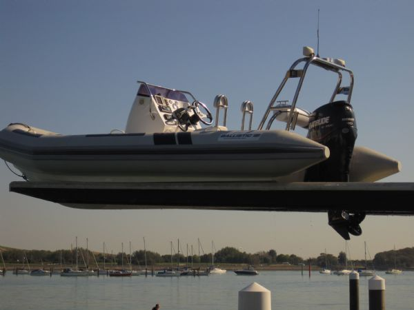 ballistic 5.5m with evinrude e-tec 90hp outboard engine sat on forks drystack_l
