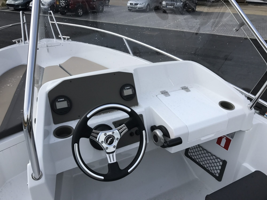 Stock - 1460 - Finnmaster 55 SC Day Boat with Yamaha F70HP Outboard Engine - Console and digital engine gauge