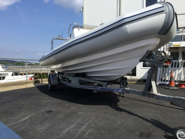 stock - 1323 - ballistic 6.5 (wigan) with evinrude 150hp outboard - hull and trailer_l