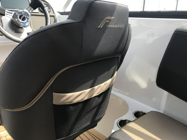 stock - 1461 - finnmaster 62 day cruiser with yamaha f150hp engine - pilot seat logo and storage_l